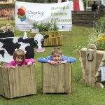 Chorley Council Flower Show Astley Park Chorley Isobel Pearson age 3 and a half with brother Thomas, age5